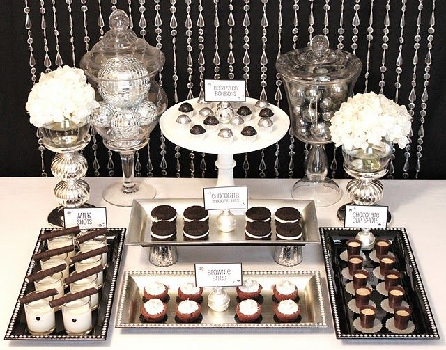 black and white and silver dessert table @Anna Beth I think you have some similar shaped serving pieces and they'd be so pretty with chocolate goodies like these!