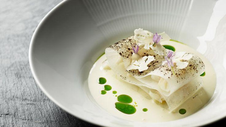 Cod and chive oil at our Michelin star restaurant Kokkeriet, Copenhagen - Denmark.