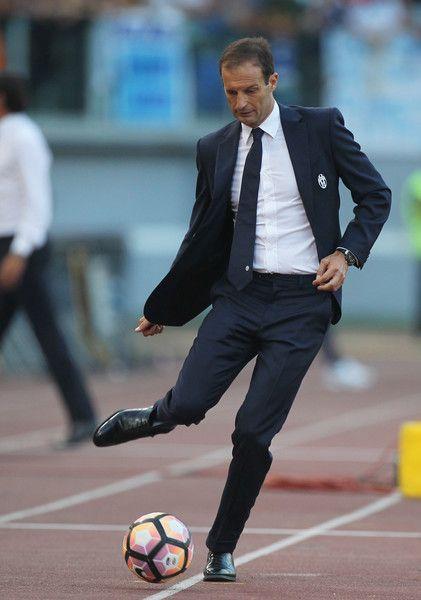 Juventus FC head coach Massimiliano Allegri kicks the ball during the Serie A…