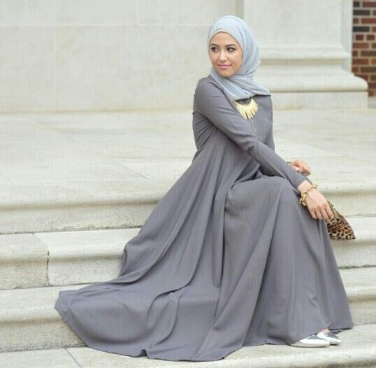 Muslima wearing a gray flowy dress!