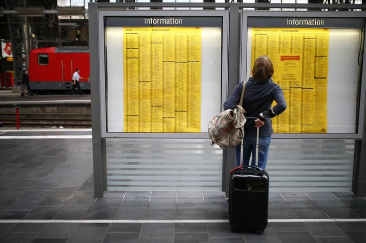 A passenger checks a train table at the main railway station in Frankfurt, October 17, 2014. German train drivers will stage a nationwide strike for the second time this week in a drawn-out dispute over pay and conditions with state-owned rail operator Deutsche Bahn, union GDL said on Friday. (REUTERS/Ralph Orlowski)