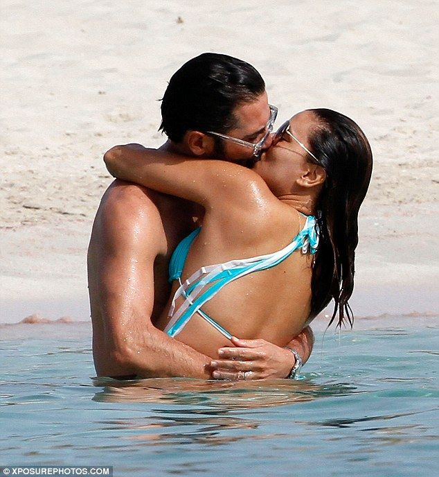 Eva Longoria puts on a very steamy display with husband Jose Baston as they frolic in the sea in Spain!