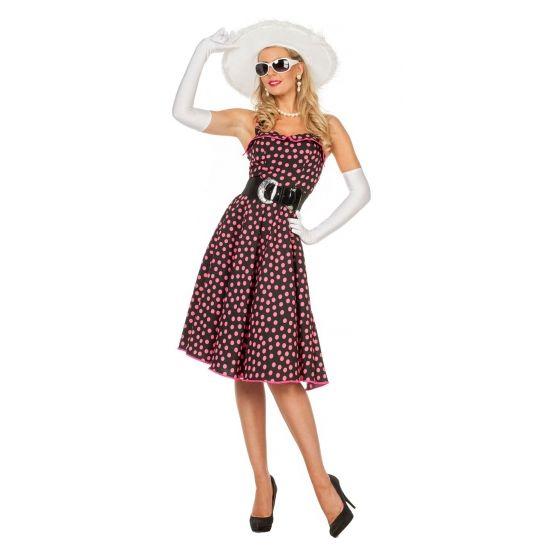 Rock en roll jurkje met roze stippen  Zwarte fifties jurk met roze stippen voor dames. Zwarte jurk in jaren 50 stijl met roze stippen en een bijpassende riem. Bijpassende accessoires zoals handschoenen hoeden parelkettingen en petticoats zijn los verkrijgbaar in onze webshop.  EUR 37.95  Meer informatie