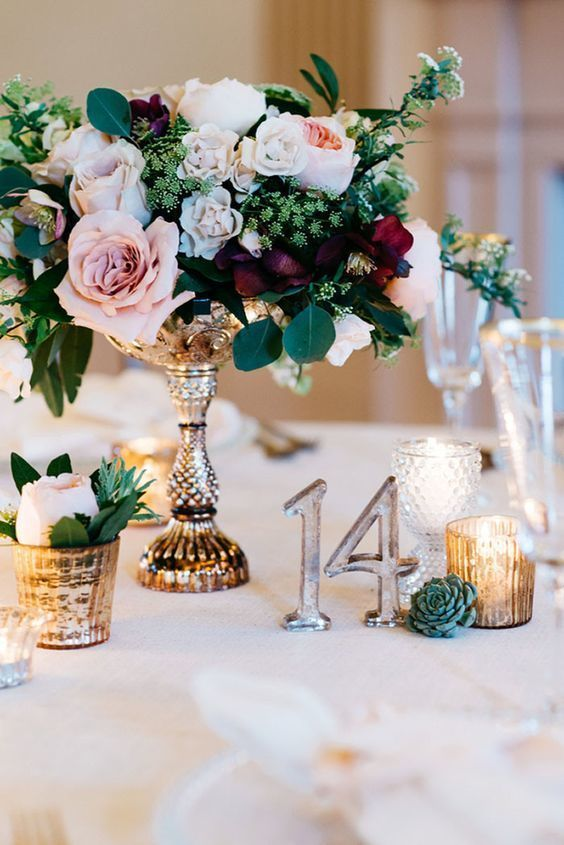 Garden Wedding Centerpiece Inspiration | The array of colors in this jewel tone inspired color palette is stunning, not to mention the gold pedestal vase. The bride paired the vase with mercury glass candles and matching table numbers.