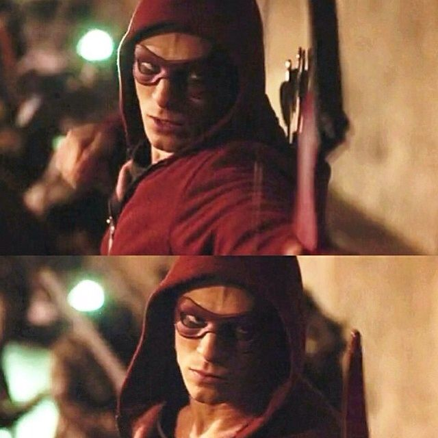The CW Arrow Roy Harper aka Red Arrow shooting his bow with a mask in the Season 2 finale.