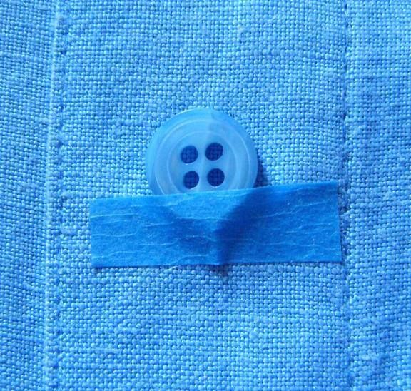 painter tape to hold buttons in place while sewing it