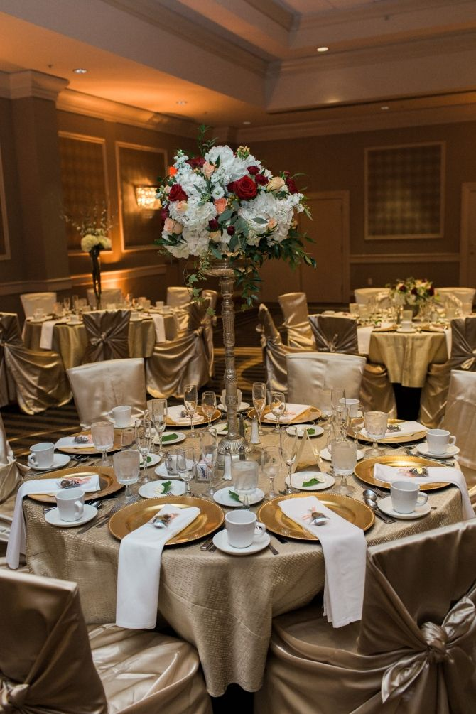 Combining tall and short centerpieces add visual