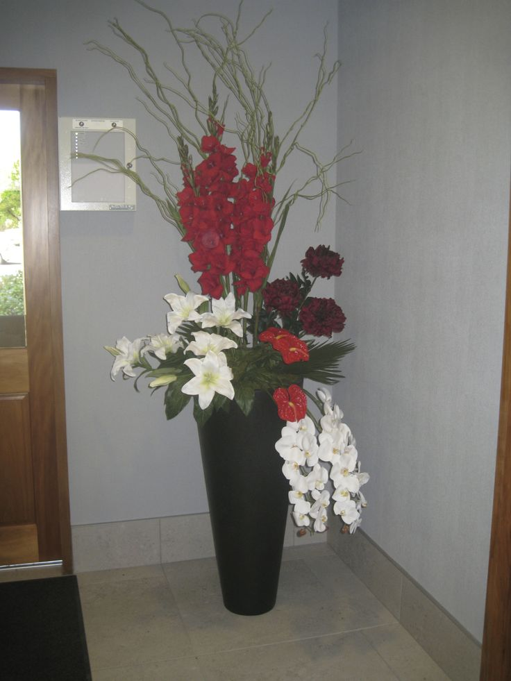 Entrance Arrangement Red Gladioli , White Oriental lilies, Red Peonies, Green Willow, Red Anthuriums, White Phalaenopsis