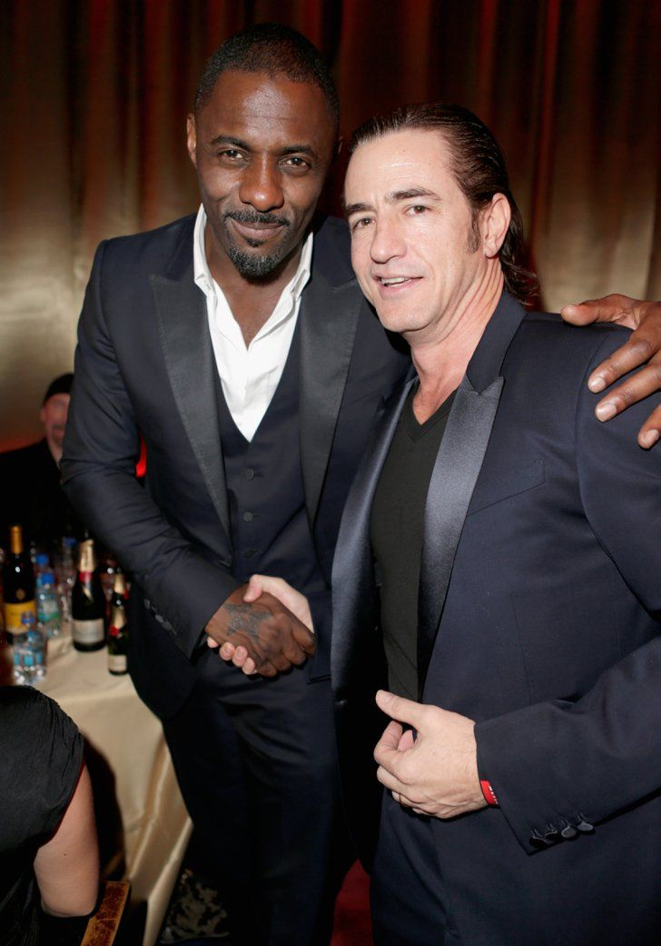 Pin for Later: Everyone Wants a Piece of Idris Elba With Dermot Mulroney