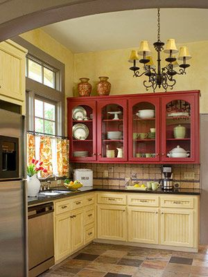 Red/Yellow colors in the French country kitchen. I love this combination & love that the kitchen design looks open in scale instead of closed off like a lot of cottages are small little rooms...