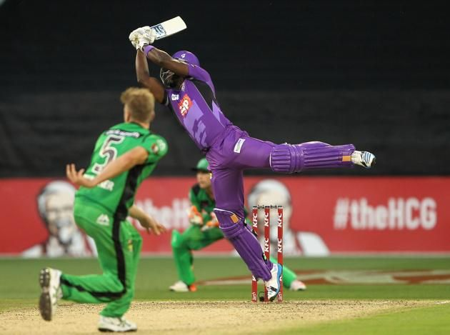 Darren Sammy of the Hurricanes plays a shot during the Big Bash League match between the Melbourne Stars and the Hobart Hurricanes at Melbourne Cricket Ground on December 20, 2014 in Melbourne, Australia.