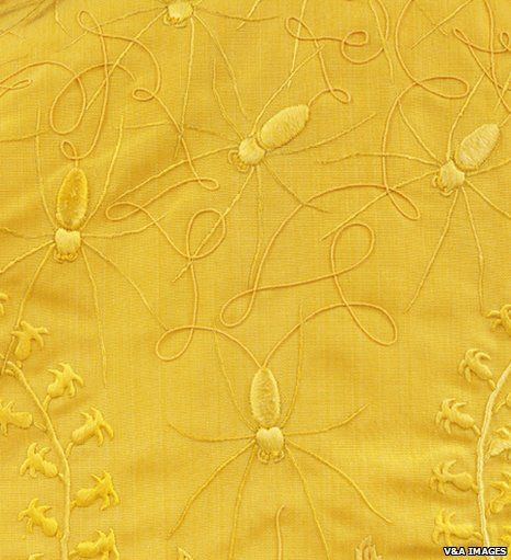 silk from the Golden Orb Spider was collected and spun into cloth to create a cloak and a scarf. This colour is naturally occurring - it's how the spiders make it. On exhibit in London from mid January, 2012