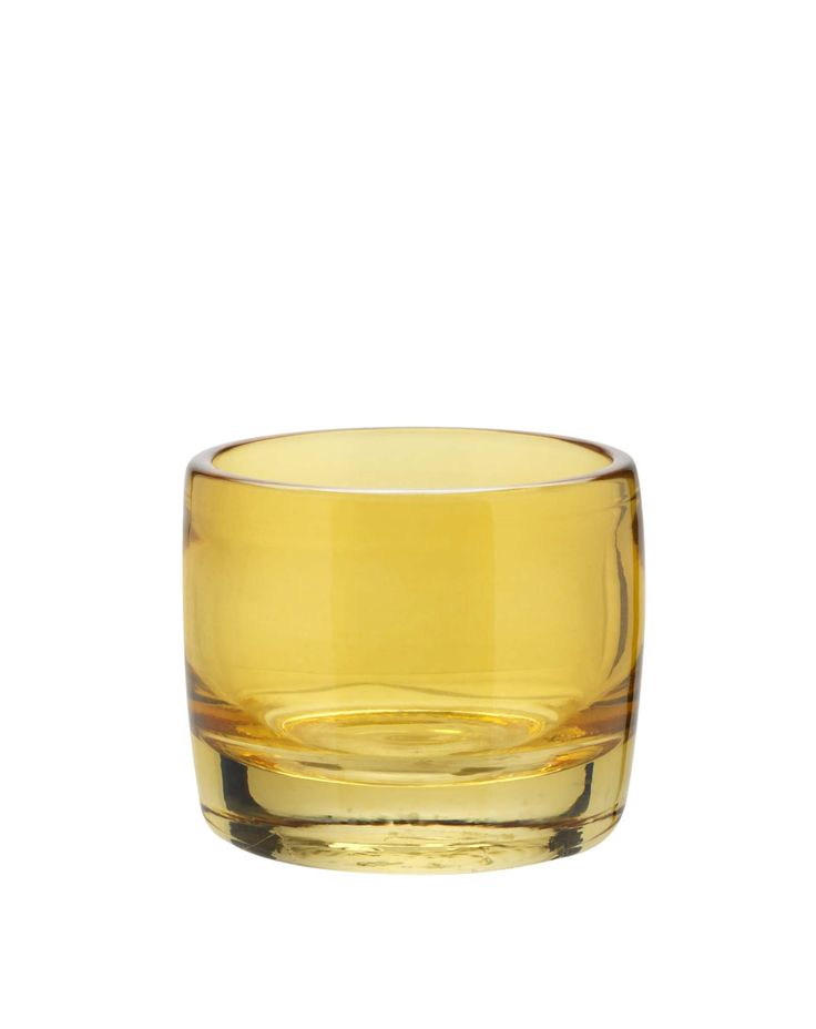 Mix-and-match this yellow glass votive for a mismatched style.  Priced at £3.