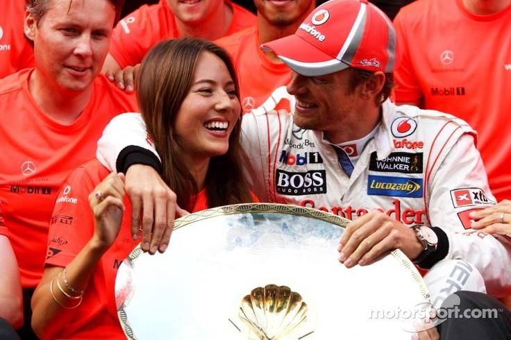 Jenson Button celebrates with Jessica Michibata, and the team