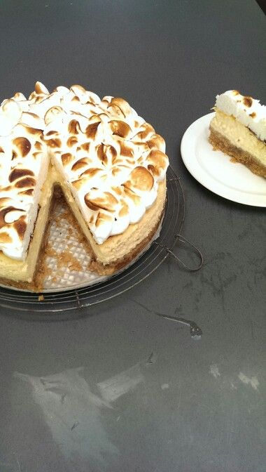 Lime cheese cake with coconut meringue and a smudge on the table...