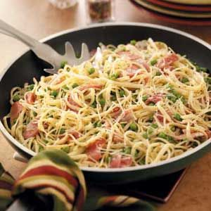 Prosciutto Pasta Toss -- we call it ham pasta.  I omit the peas and use smoked deli ham.  Can easily be adapted for one person. One of my favorites!