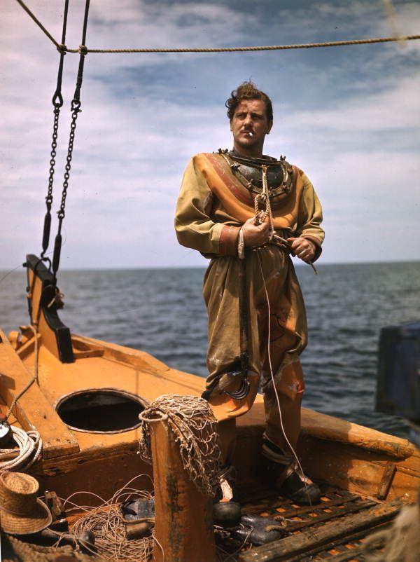 A sponge diver puts on his suit in Tarpon Springs (ca. 1940). | Florida Memory