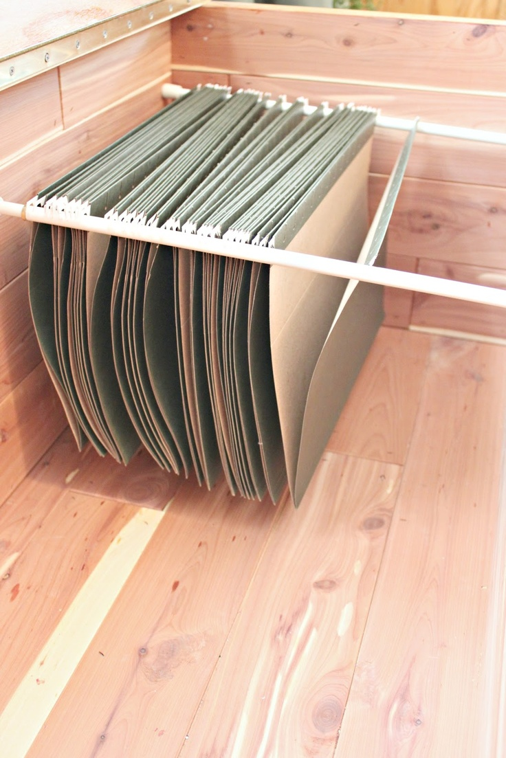 all you need is two curtain tension rods and you can turn anything into a filing cabinet!