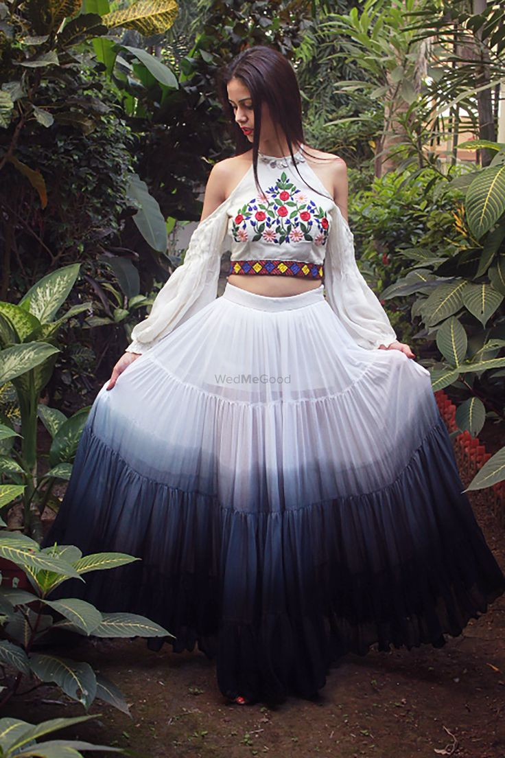 Unique ombré lehenga with cold shoulder cape sleeved blouse with white and navy blue! | WedMeGood|#wedmegood #indianweddings #capesleeves #ombrelehenga #lightlehenga #coldshoulderblouse #whitelehenga