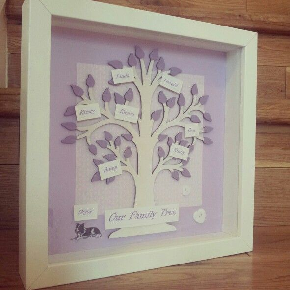 Wooden family tree frame with pet dog