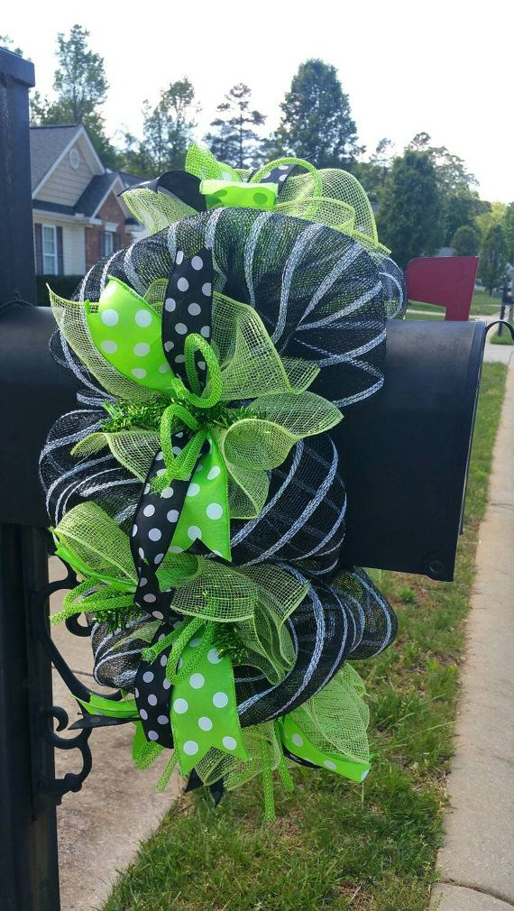 This mailbox wreath is made with a black and silver striped mesh, lime mesh ruffles, 2 tyoes of wired ribbons, and flex tubing. Its sure to