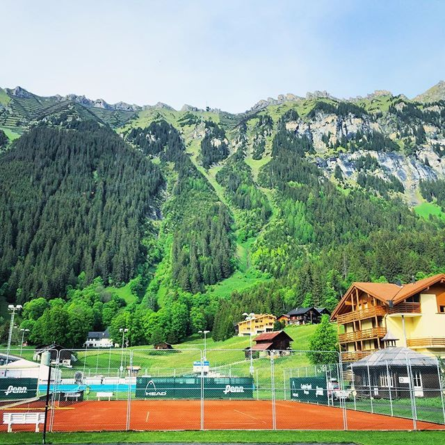 Would you like to play tennis here?   This is Switzerland   While coming down from the highest peak of Europe, Jungfrau, we got down at one of the railway stations named Wengen to better enjoy the views which we were enjoying from the train. Since we had rail passes we could take any next train   .  .  .  #thetravelspeak #switzerland #europe #eurorail #eurotrip #travel #travelblogger #traveling #traveltips #travelbug #globetrotter