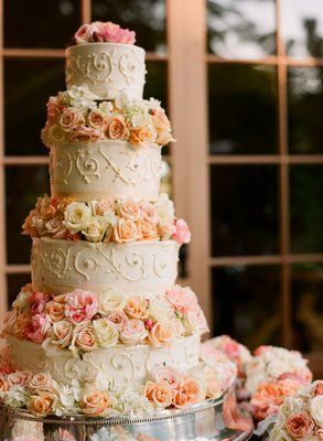 """""""This cake will be 4 tiers. 2 tiers will be of the traditional mexican tres leches cake with kauhla!"""" Sounds yummy and I love the scroll work design."""