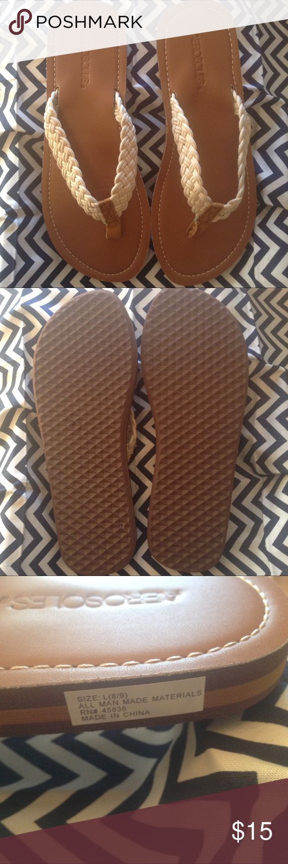 Women's Aerosoles Rope Style Flip Flops Large(8-9) New, Never Worn Aerosoles Women's Flip Flops Size Large (8-9). Camel color sole with light beige stitching to match braided rope style straps. These are traditional style flip flops made of rubber/foam material. AEROSOLES Shoes Sandals