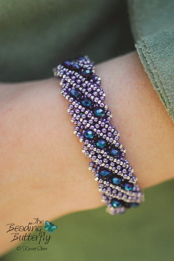 Using diagonal faux right angle weave, create a dimensional and reversible bracelet that can be worn two different ways to suit your mood. This is an experienced beginner to intermediate project. Previous knowledge of right angle weave is not required but would be very helpful. Feel free to sell what you make from this pattern; I only ask that you credit Kassie Shaw and/or The Beading Butterfly in any print or online photograph or listing. Please do not make copies of the pattern, teac...