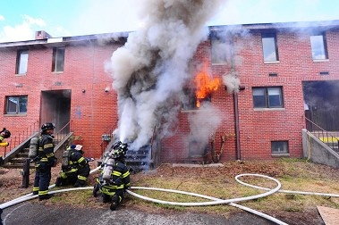 Firefighters battle a cellar fire on Governors Island, to help the FDNY, NIST and UL learn more about the science behind today's fires