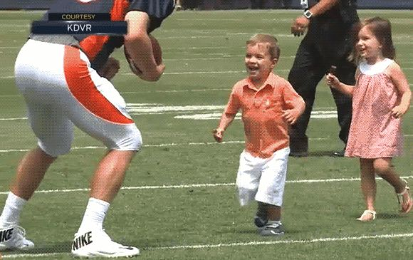 Peyton Manning greets his two young children and gets tackled by his son in this adorable clip. (Courtesy of KDVR)