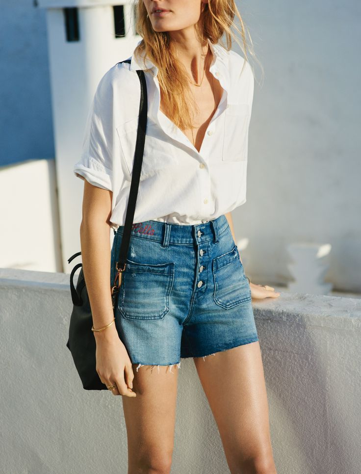 madewell high-rise denim shorts worn with the courier shirt + mini transport crossbody