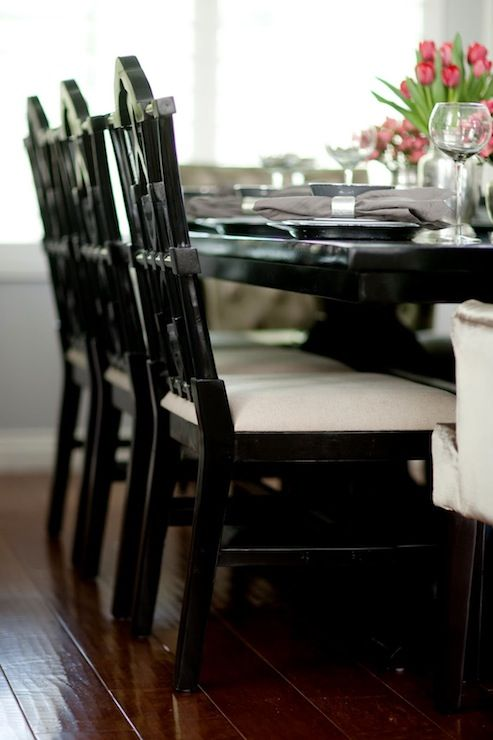 Chinoiserie Dining ChairsStunning dining room with Noir Emperor Side Chairs in Distressed Black lining a black dining table over hand-scraped hardwood floors.