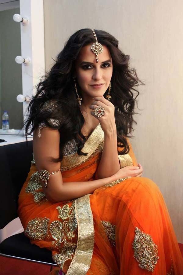 Bollywood Actress Neha Dhupia Latest Photoshoot in Orange Color Saree Golden Border Saree
