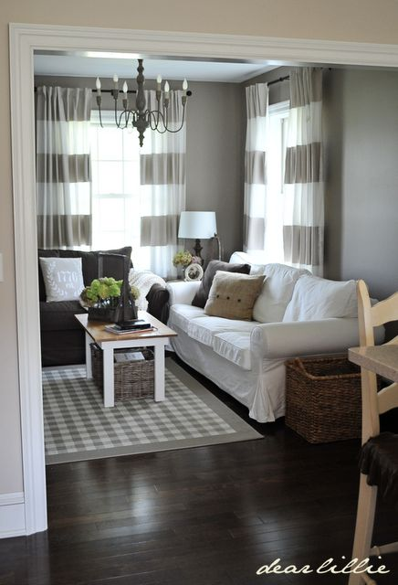 Such A Darling And Cozy RoomDIY Farmhouse Coffee Table DIY Painted Curtains White Couch Rug Baskets From IKEA Dear Lillie Jamie Joshs New Den