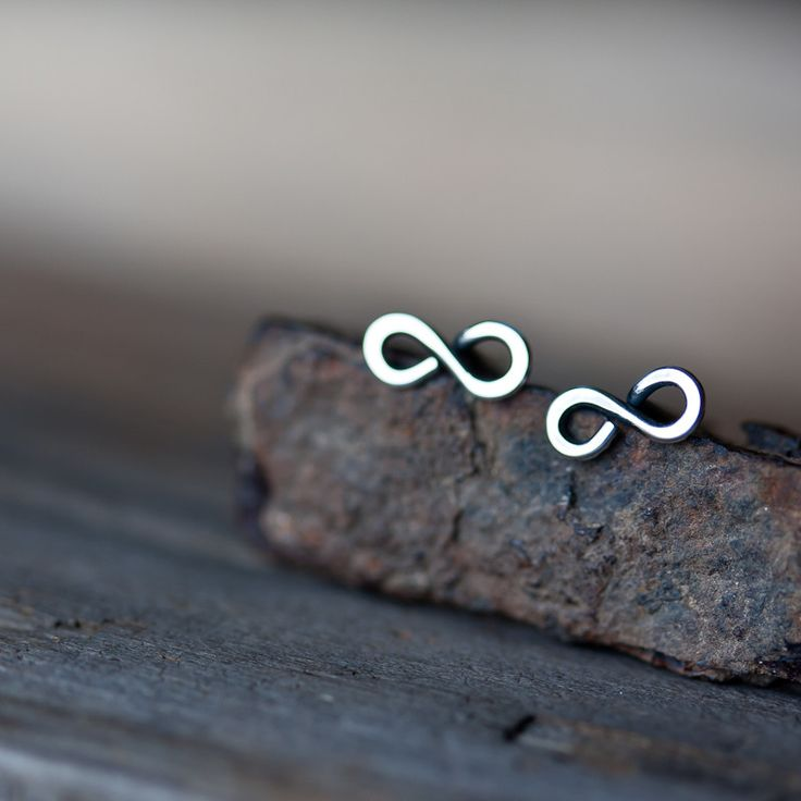 Small and lovingly hand crafted infinity shape earrings formed from continuous length of solid sterling silver wire. This simple shape is loved by both men and women alike, and it is truly unisex. The
