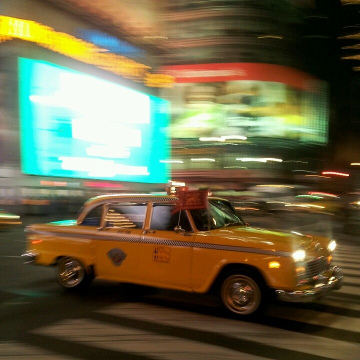 Old school yellow cab captured at Times Square