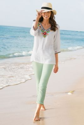 Featuring vibrant floral embroidery and beading, this white linen tunic  will leave you feeling like you've escaped to paradise!