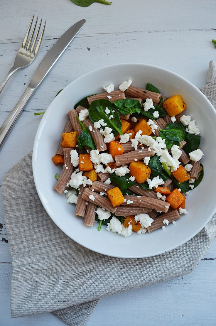 A light and delicious pasta dish, made with rosemary roasted butternut squash, wilted spinach and hearty spelt rigatini, topped with crumbled feta.