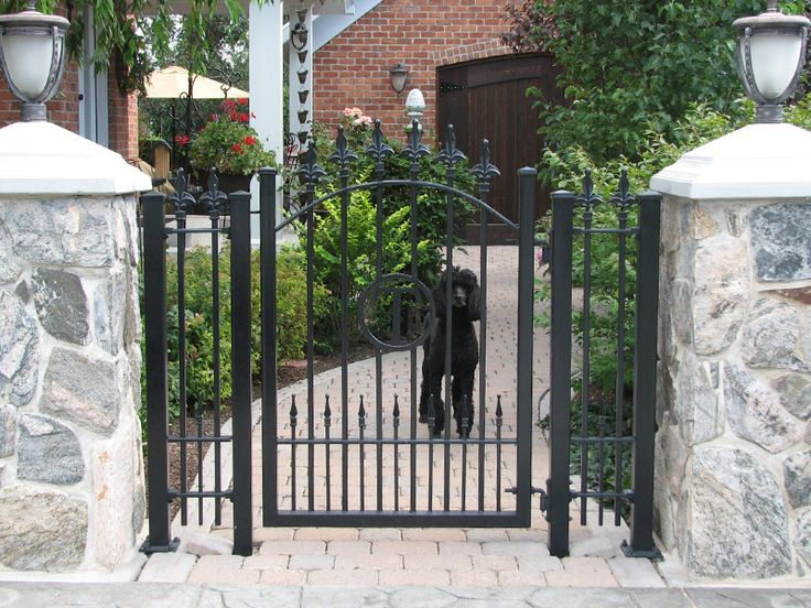 Stone Fence Pillars : A single gate paired with stone pillars that complement