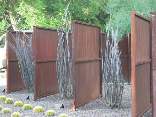 I like to use fence panels, these look pretty cool with the adjacent plants and the uplighting. From modernphoenix.nt