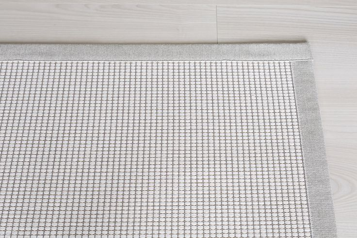 Lyyra is made of recycled cotton and paperyarn. Inhouse design of VM-Carpet.