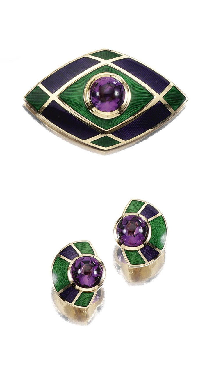 GOLD, ENAMEL AND AMETHYST DEMI-PARURE, LEO DE VROOMEN.  The brooch designed as a lozenge, centring on a collet-set circular buff top facetted amethyst, within a purple and green guilloché enamel ground, maker's marks for Leo de Vroomen, British hallmarks for London, 1993, accompanied by a pair of ear clips of similar design, clip fittings, signed de Vroomen, British hallmarks for London, 1994, maker's marks.
