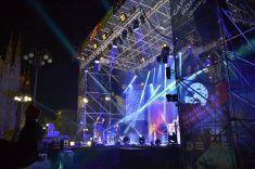 Nadia Mikushova. Italian popular rapper Caparezza singing during Milan New Year's concert. stock photo