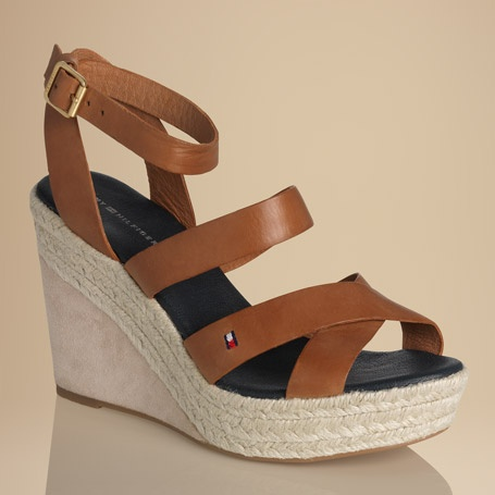 Stand out in these eye-catching sandals. Leather upper with cross-over styling across the toes. Tommy Hilfiger flag embroidered on the outside. Leather buckle strap around the ankle. Cotton lining for ultimate comfort on warm days. Leather sock lining with Tommy Hilfiger logo embossed at the 10.3cm heel. Jute-covered plateau with a suede-covered wedge heel. Rubber outsole. Turn heads with a splash of colour and sassy style.