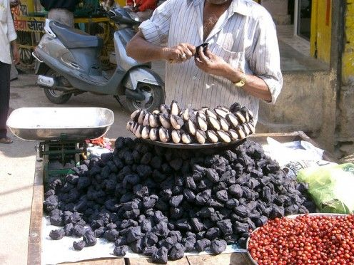 #Singhara is the black colored fruit with a white seed as seen in this photograph #Street #Food #India #ekPlate #ekplatesinhara