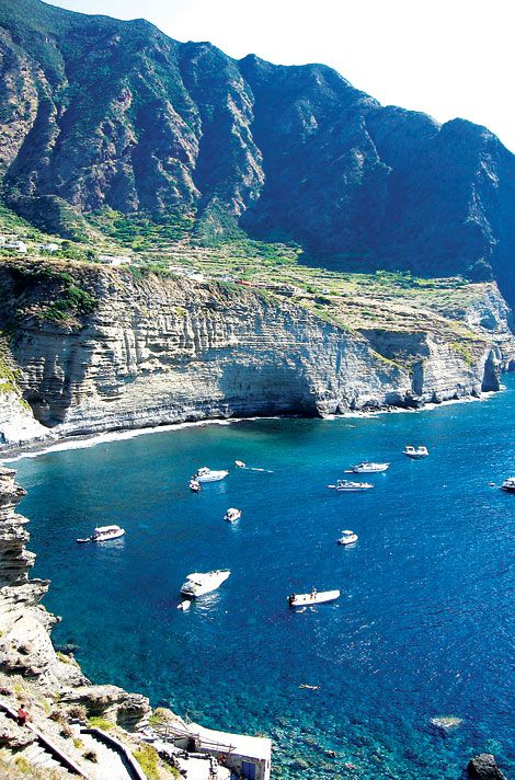 One of seven small Aeolian Islands cast up by volcanoes in the Tyrrhenian Sea about 50 miles north of Sicily. The location for the film 'Il Postino'