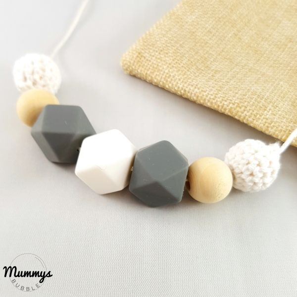 This beautifully simple necklace gives you as a Mama a classic and sophisticated air. The use of greys and whites provide a monochrome look that will fit any type of style. The use of versatile textures with the round wooden and hexagonal silicone beads helps to create a comforting effect for your teething baby. Matched with the crotchet beads, this handy teether will offer a varied feel for your little mini me.
