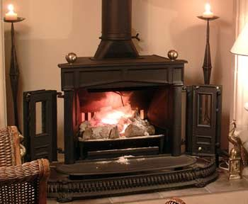 Country Franklin stove with small open doors