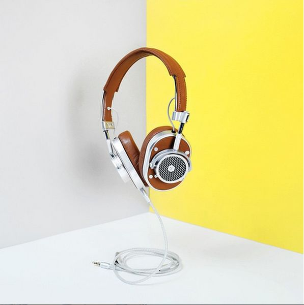 A built-in mute button, microphone capabilities and optional custom-designed stand make Master & Dynamic's award-winning over-ear headphones a natural desk accessory, though the headphones come replete with a leather cable box and canvas bag for stylish travel.  http://sorrythanksiloveyou.com/accessories/technology/mh40-headphones-master-and-dynamic